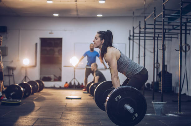 Woman training in gym stock photo