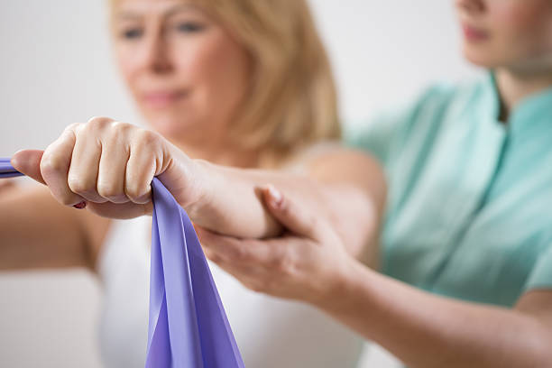 Woman training with exercise band stock photo