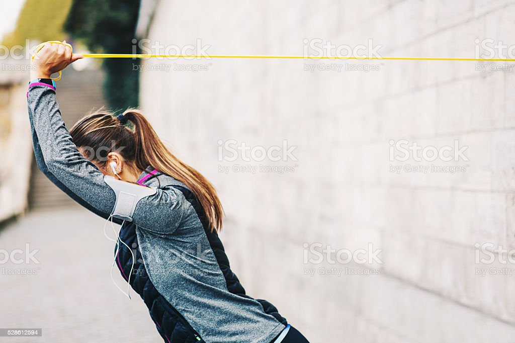 Woman training with resistance band stock photo