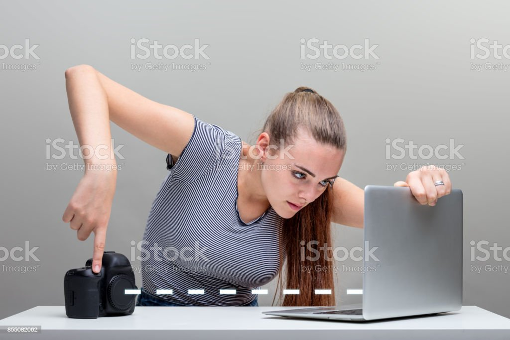 woman transfers pictures from her digital camera stock photo