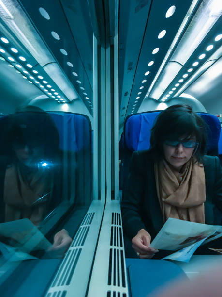 Woman travel in a train stock photo