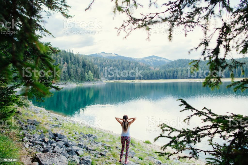 woman travel in beautiful lake and forest stock photo