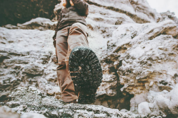 Woman traveler climbing at rocky mountains Travel Lifestyle wanderlust adventure concept summer vacations view under feet boots perspective Woman traveler climbing at rocky mountains Travel Lifestyle wanderlust adventure concept summer vacations view under feet boots perspective sole of foot stock pictures, royalty-free photos & images