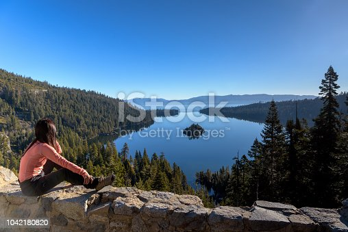 A woman traveler enjoying view of Emerald Bay in the morning, California, USA
