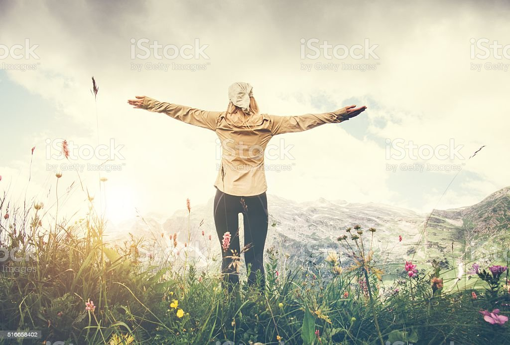 Woman Traveler hands raised hiking Travel Lifestyle concept stock photo