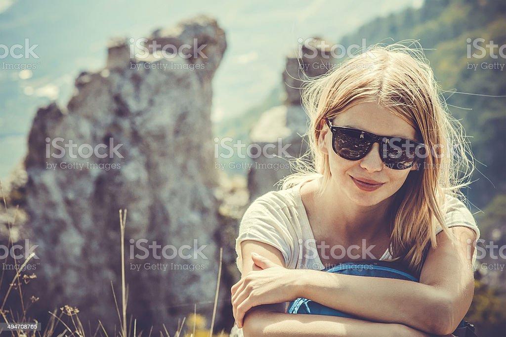 Woman Traveler hiking in Mountains stock photo
