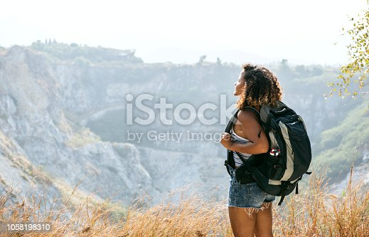 Woman traveler looking at mountain