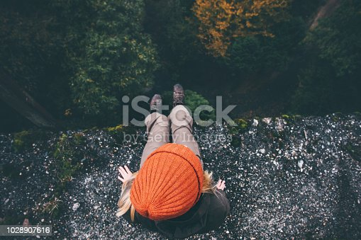 Woman Traveler sitting on cliff bridge with forest aerial view Travel Lifestyle adventure vacations concept