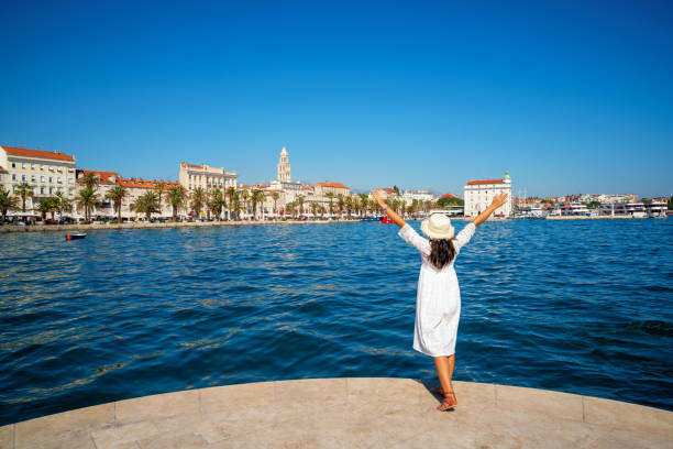 Woman traveler travel to old town of Split in Dalmatia, Croatia. Split is the famous city and top tourism destination of Croatia and Europe. stock photo