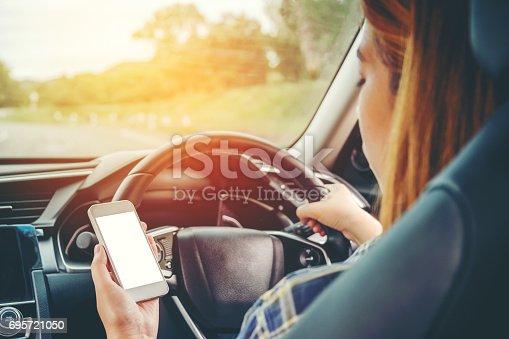 istock Woman traveler Using Smart Phone Car Inside 695721050
