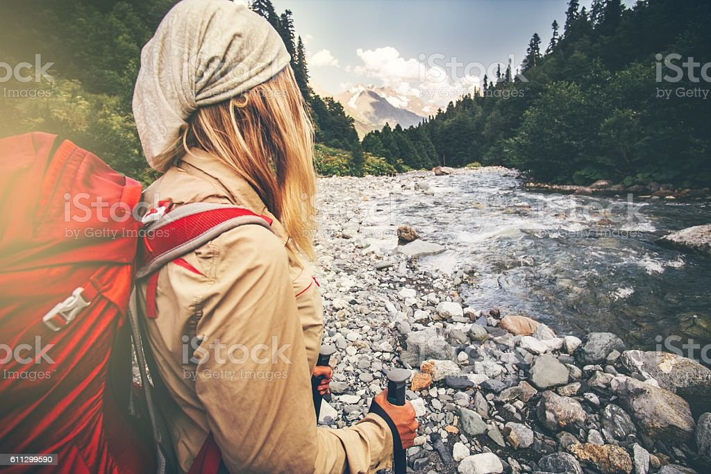 Woman Traveler with backpack hiking Travel Lifestyle stock photo