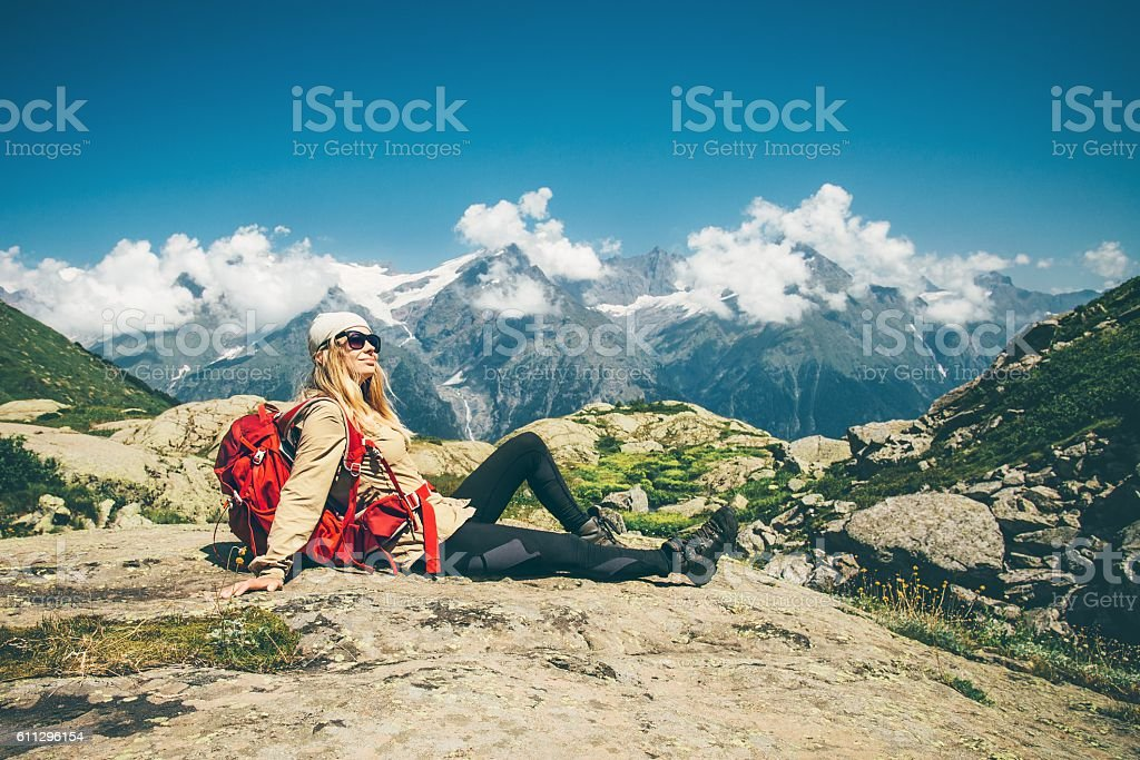 53542c79234 Woman Traveler with backpack relaxing with mountains landscape Travel  Lifestyle royalty-free stock photo