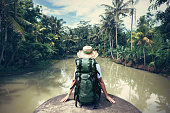 istock Woman traveler with backpack sitting on the edge 522001452