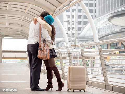 842907838 istock photo Woman traveler with bag, luggage, suitcase hug her boyfriend when arrival/departure at the airport during travel 902846068