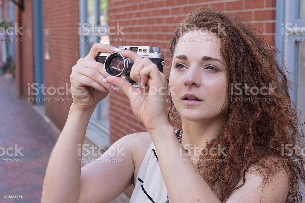 Woman Traveling and Taking Photos in old city stock photo