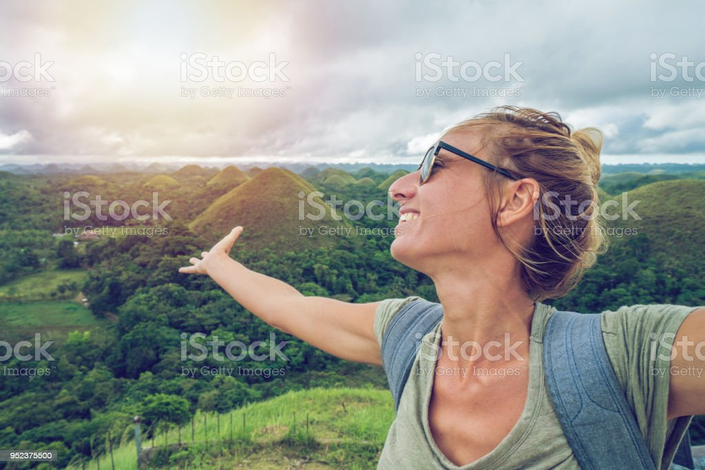 Woman Traveling Arms Outstretched At Chocolate Hills Of Bohol Philippines  Stock Photo & More Pictures of 30-39 Years