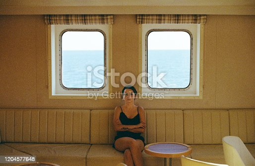 Young Caucasian woman traveling by ferry in Norway