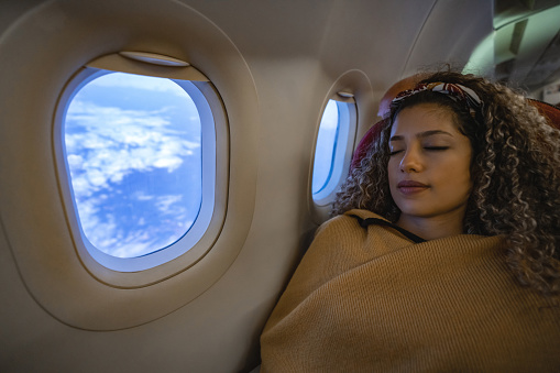 Woman Traveling By Plane And Sleeping Stock Photo - Download Image Now
