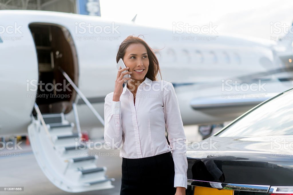 Woman traveling by plane and talking on the phone stock photo