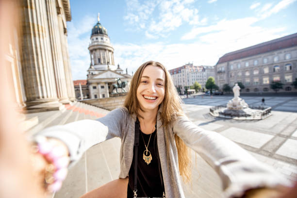 woman traveling in berlin - concert selfie stock photos and pictures