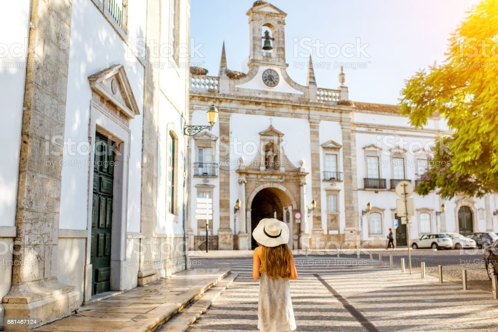 Woman traveling in Faro town on the south of Portugal stock photo