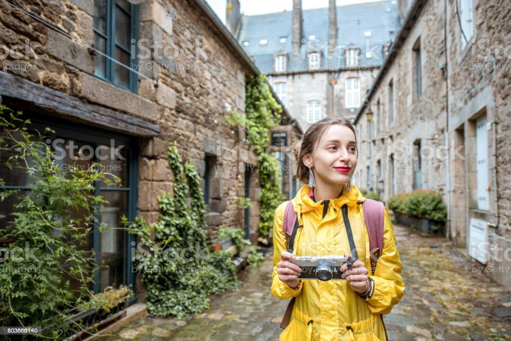 Woman traveling in french town Dinan stock photo