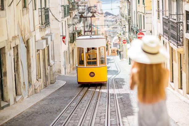 woman traveling in lisbon, portugal - eletrico lisboa imagens e fotografias de stock