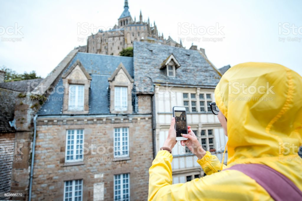 Woman traveling in Mont Saint Michel stock photo