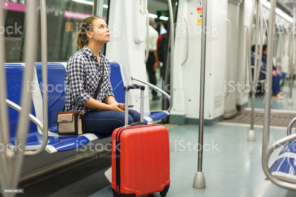 Woman traveling in subway car stock photo