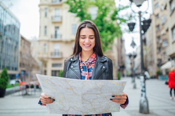 Woman traveling, looking the map stock photo