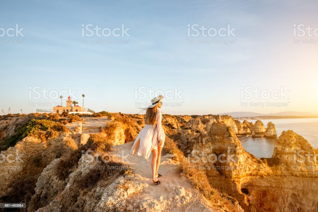 Woman traveling on the rocky coastline in Lagos, Portugal stock photo