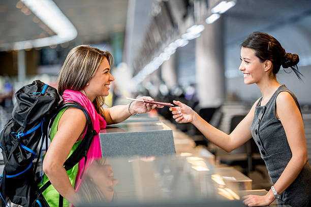 woman traveling - airport check in counter stock pictures, royalty-free photos & images
