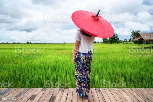 Woman traveller hiking asian rice field landscape picture id982444220?b=1&k=6&m=982444220&s=612x612&h=tmew2cidryhhzfehfifukxmvdl3cto eppvhlx6z8ww=