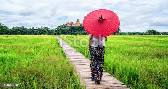 istock Woman traveller hiking Asian rice field landscape. 994646242