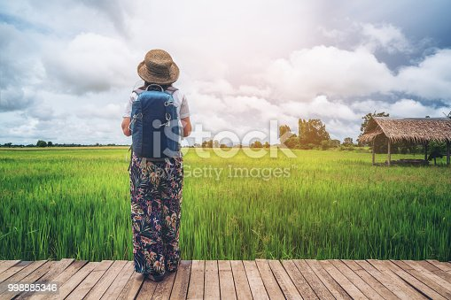 istock Woman traveller hiking Asian rice field landscape. 998885346