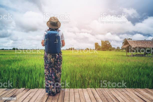 Woman traveller hiking asian rice field landscape picture id998885346?b=1&k=6&m=998885346&s=612x612&h=poohnns9 lmdjbclm nyrphofy5ux8fcge9kj67lxia=