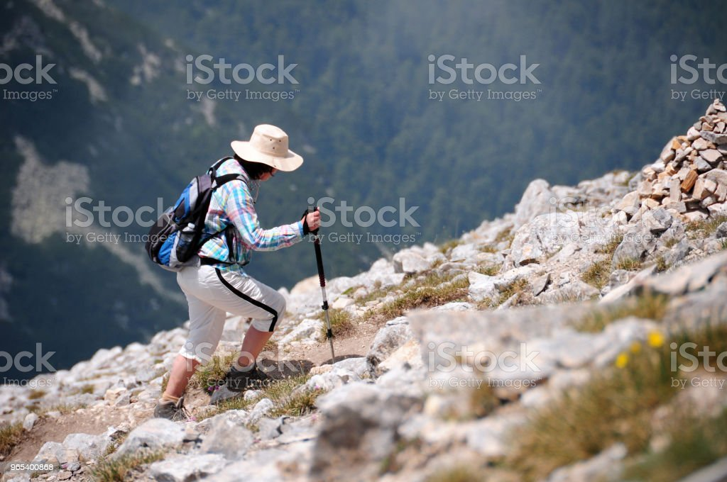 Woman trekking high mountains royalty-free stock photo