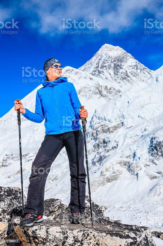 Woman trekking in Himalayas, Mount Everest on the background, Nepal royalty-free stock photo