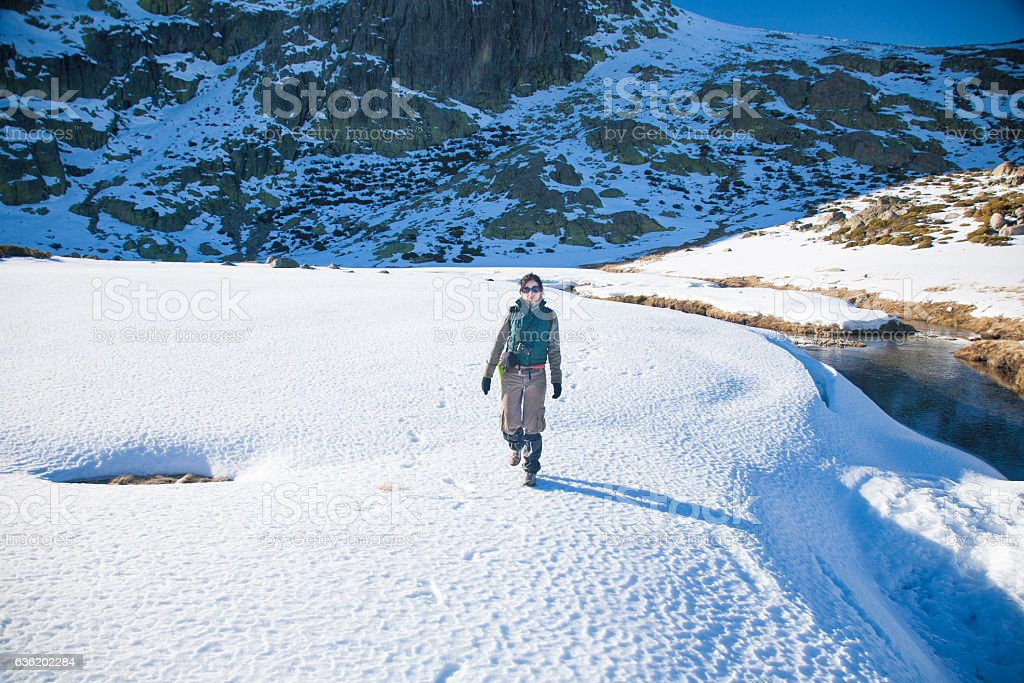 woman trekking in snow stock photo
