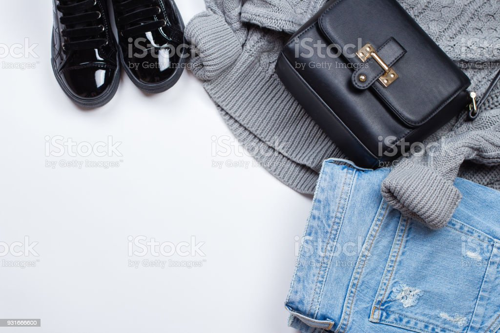 Woman Trendy Fashion Clothes Blue Jeans Knitted Gray Sweater Patent Leather Shoes Boots And Accessories Black Bag On White Background Flat Lay Top View Copy Space Stock Photo Download Image Now