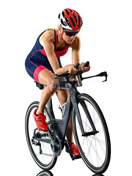 woman triathlon triathlete ironman athlete  cyclist cycling isolated white background stock photo