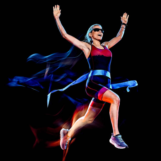 woman triathlon triathlete runner running joogger jogging  isolated black background stock photo