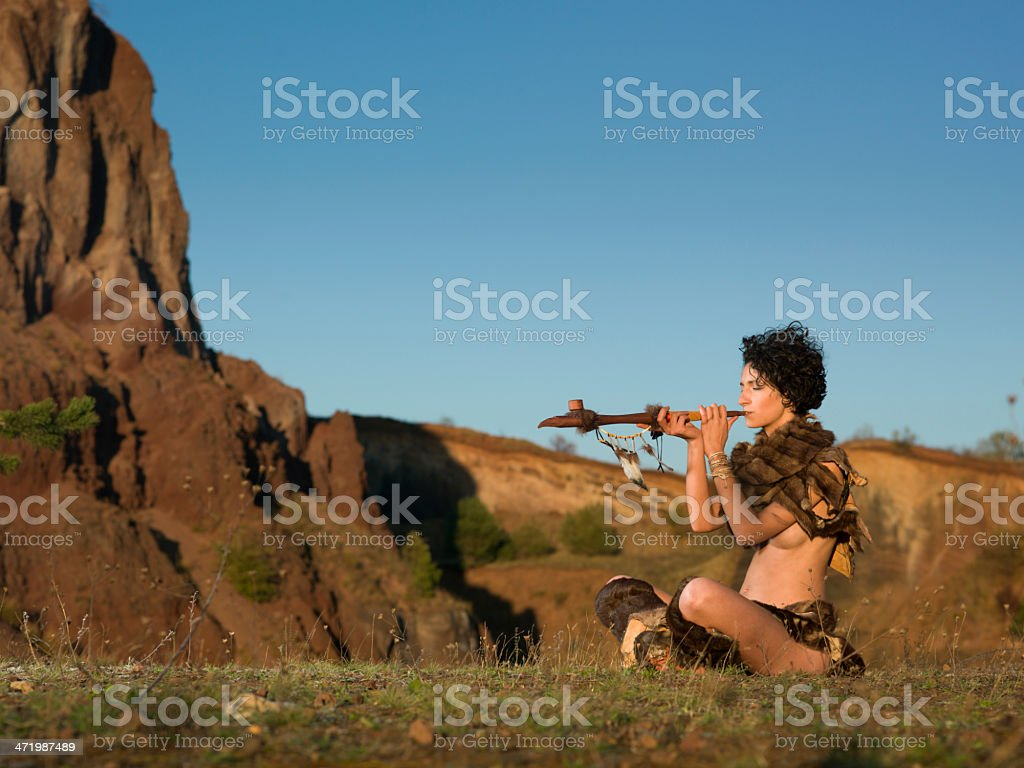 woman tribe smoking from peace pipe stock photo