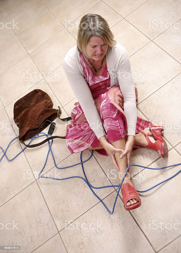Woman tripped over an electrical cord stock photo