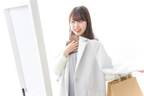 Woman try on a cloth Woman try on a cloth coat garment stock pictures, royalty-free photos & images
