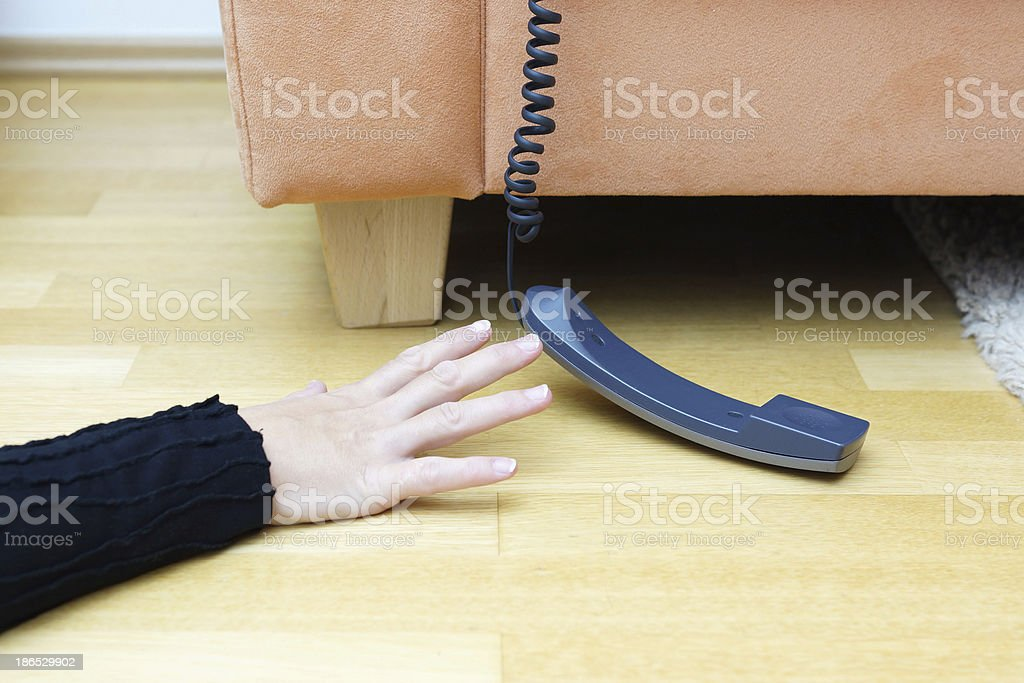 woman  try to reach the phone stock photo