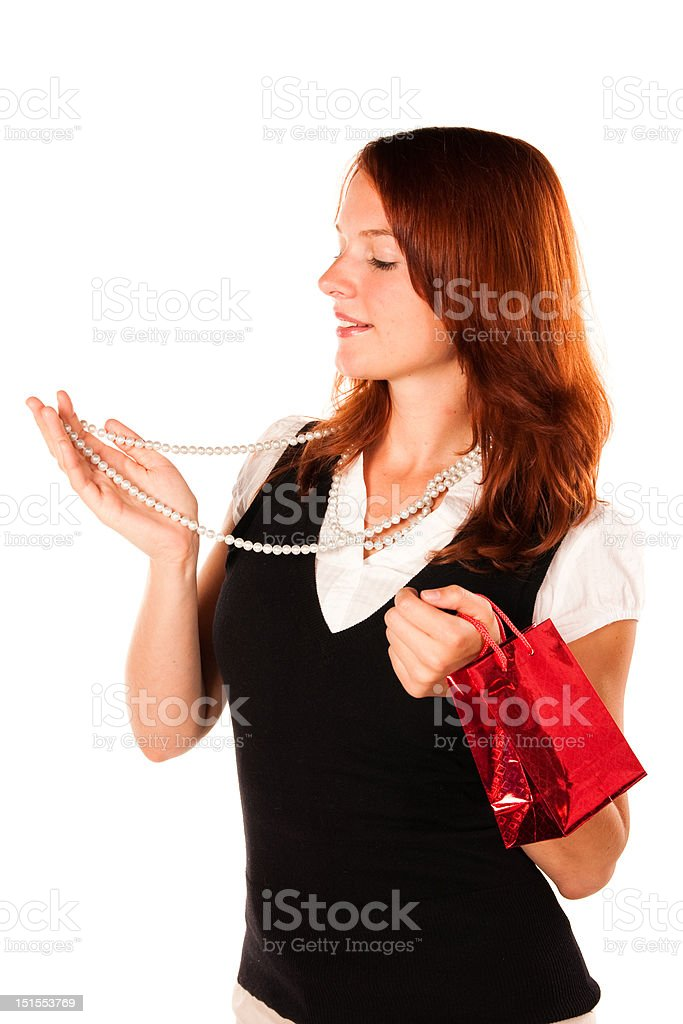 Woman trying a new necklace. Zoomed in shot. royalty-free stock photo