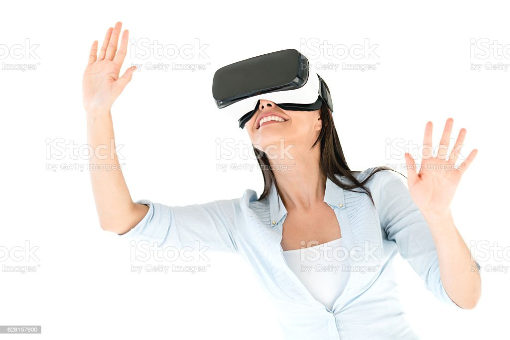 Woman trying a VR device ストックフォト