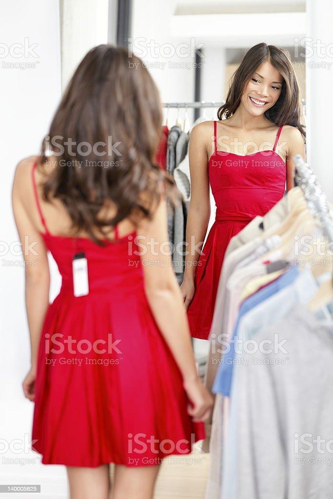 Woman trying dress stock photo