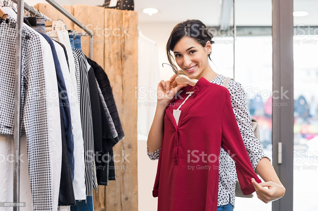 Woman trying new cloth stock photo